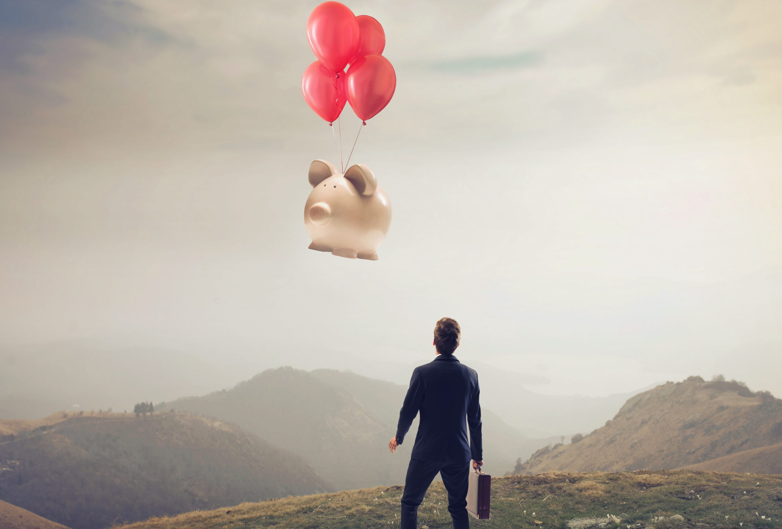 Costly mistake of business person looking at piggy bank flying away with some balloon